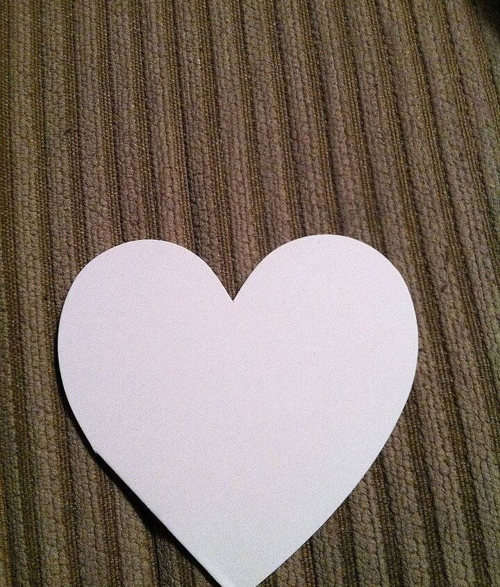 Cut a heart out of cardstock and cover it in scrapbook paper or wrapping paper.