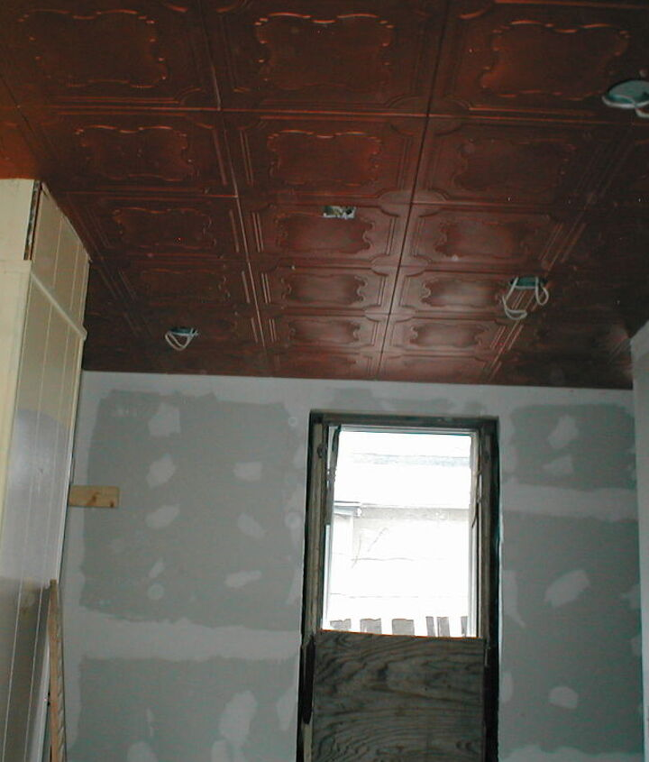styro-tiles painted copper to match the copper accents throughout the kitchen.