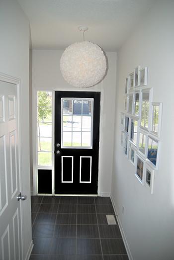 The light fixture hung up above the door