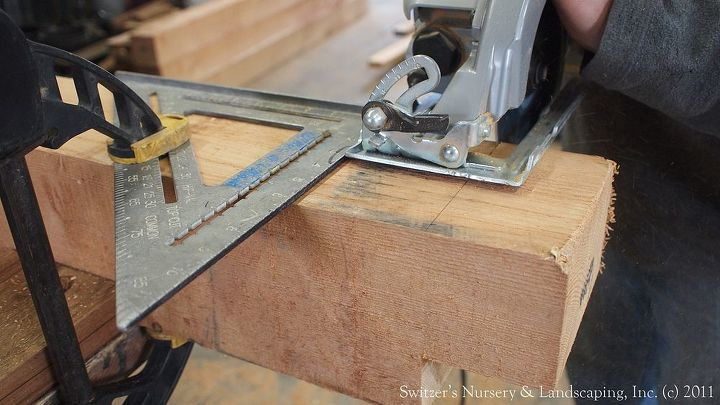 Notching out the post with a circular saw.  Clamp a speed square to the post for a guide to a square cut.  Make several cuts and remove the small pieces by hand.