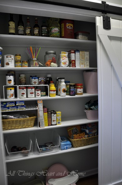 The pantry stretches across the whole wall and the door opens to one side or the other...