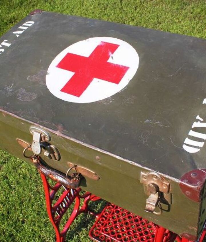 Custom graphics were stenciled and painted onto the top of the vintage suitcase and then distressed.