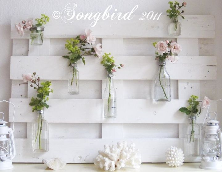 lots of variations possible with this pallet wood mantel decor, diy, home decor, how to, pallet, repurposing upcycling, Glass bottles and jars where attached to the pallet with broom holders