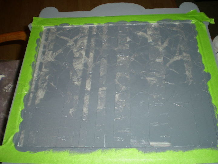 I stenciled a wooded scene on all four sides with a darker grey
